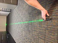 One of the suspects, a 16-year-old boy, was found to be in possession of the laser.