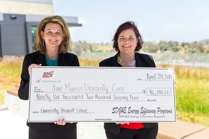 CSUSM Vice President for Finance and Administrative Services (left) accepted a check from SDG&E Director of Commercial & Industrial Services Dawn Welch (right) at a special presentation on Apr. 24.